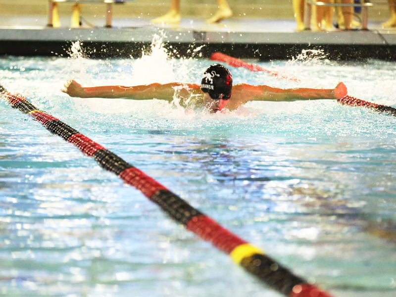 Saints Swimming and Wrestling Finish Season Strong